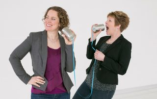 BF Bookkeeping Owners Meghan and Stacy talking on tin-can-and-string phones