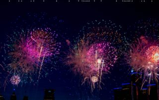 """Fireworks and letters spelling out """"happy new year""""."""