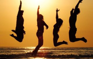 4 silhouettes jumping for joy